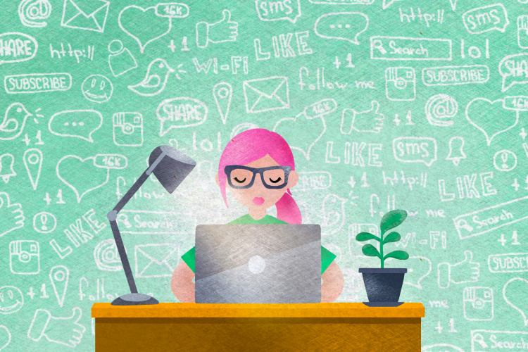 a woman with pink hair sitting in-front of the computer